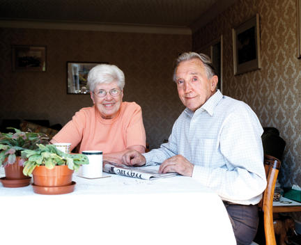Senior Couple Relaxing At Dining Room