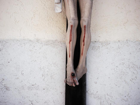 Feet Of Jesus On A Cross With Blood