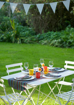 Table laid for lunch in the garden