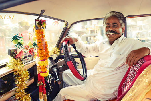 Colorful Indian taxi cab driver