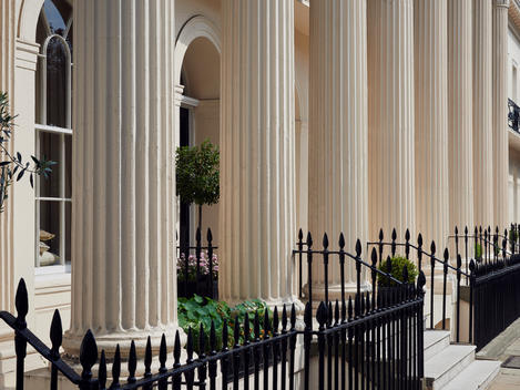 White column classical entrances with black railings