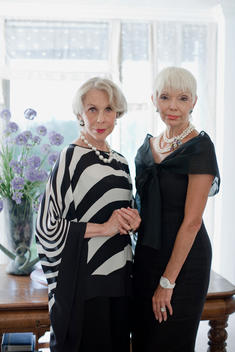 Portrait Of Two Elegantly Dressed Mature Women Showing Off Wealth