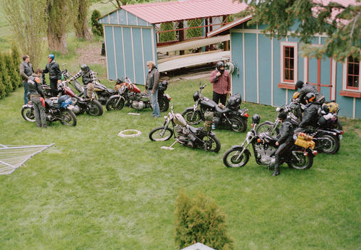 group of bikers at country house