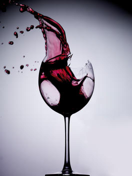 Red Wine Splashing Out Of A Wine Glass.