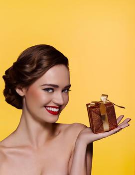 Beauty portrait of woman holding gift box