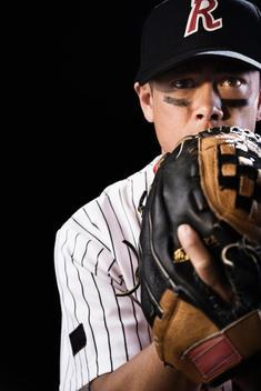 Mixed race baseball player pitching