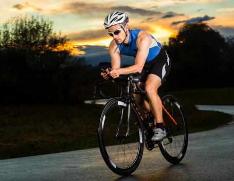 Germany, triathlete riding bicycle