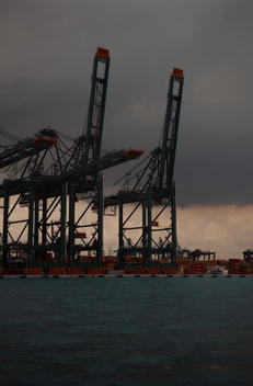 shipping container cranes from the sea