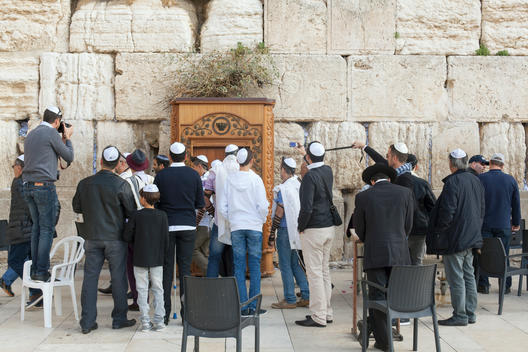 Celebrating a Bar Mitzvah at the Kotel, also known as the Western Wall, an ancient limestone wall in the Old City of Jerusalem. The wall is one of the holiest sites in Judaism.