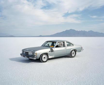 A Silver Car On The Salt Flats.