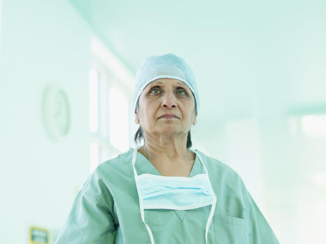 Indian surgeon in surgical cap and mask