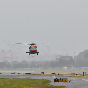 Helicopter Landing on a Runway