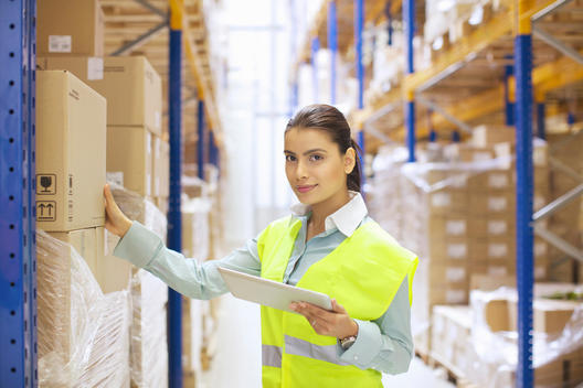 Female warehouse worker with digital tablet