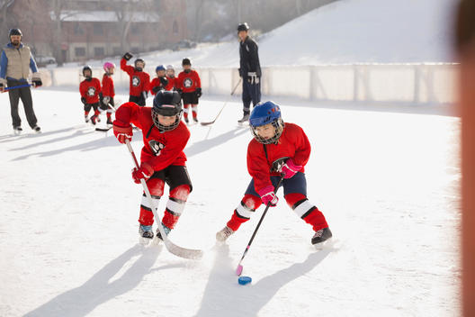 Young hockey players practicing on ice rink