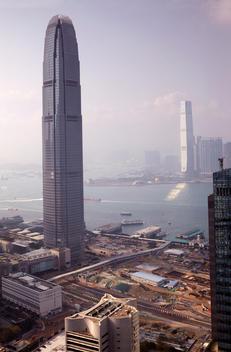 Elevated views of the twin \'International Commerce Centre\' and \'Two International Finance Centre\' in Hong Kong under blue skies