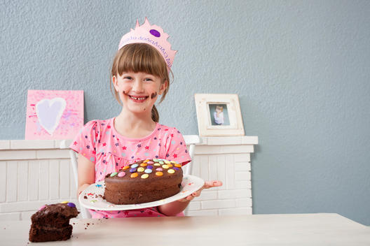 Girl showing off her birthday cake