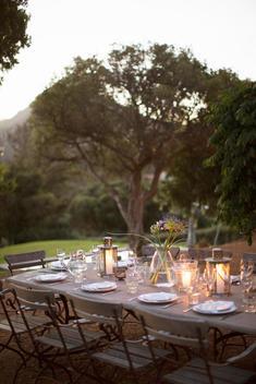 Illuminated lanterns on tranquil patio table