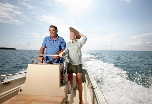 Senior Couple Driving Motorboat