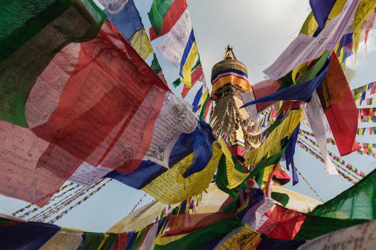 Prayer flags hanging from temple spire