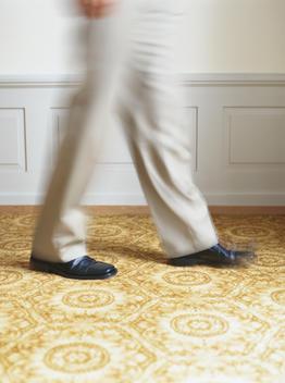 Man Walking In Hotel Room