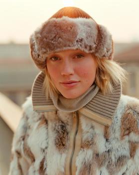 Girl In Fur Hat And Coat In Winter Light