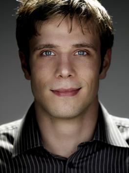 Portrait Of 20 -25 Year Old Man Of Caucasian Appearance In Studio
