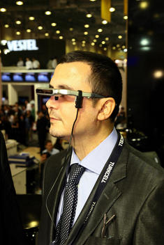 Man Wearing A Head Mounted Display At A Technology Expo, Istanbul, Italy.