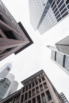 Germany, Hesse, Frankfurt, view to facades of modern office buildings from below