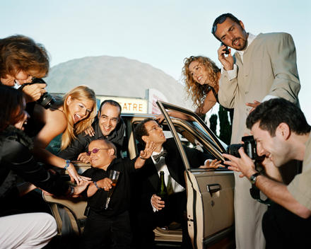 Celebrity Vern Troyer And Rich Looking People In Suits And Dresses Coming Out Of A Car In Los Angeles