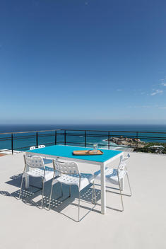 Table on patio overlooking ocean