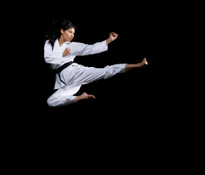 Asian woman practicing martial arts