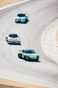 Vintage Porsche 911?s racing at Laguna Seca Raceway in Monterey California during Porsche Rennsport Reunion V.