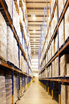 Aisle of boxes in warehouse