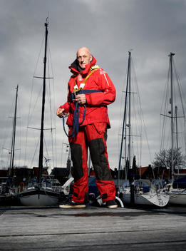 Senior Sea Sailor Standing On Dock Wearing A Sailing Suit