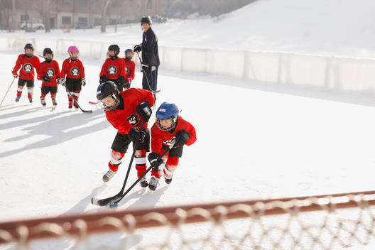 Ice hockey players skating on rink