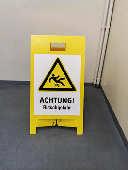 Cleaned staircase with warning: Slippery
