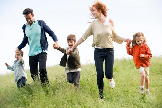 Family running together in field