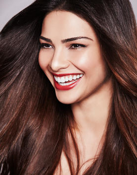 Woman with red lips laughing