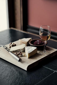 A Selection Of French Cheeses And A Dessert Wine.
