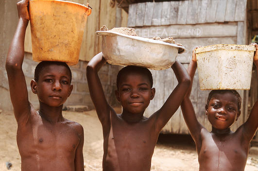 3 African Boys Carrying Water