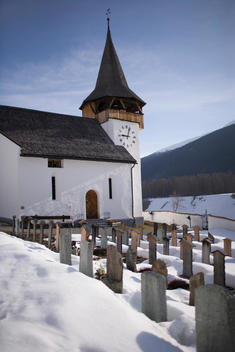 Cemetery with snow at Frauenkirchen Church