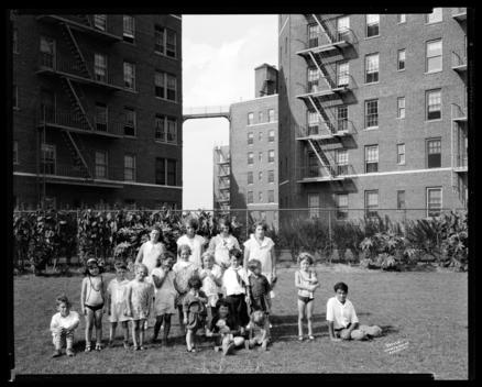 Photo To Show Children On Lawn, Open Stair Apartments.