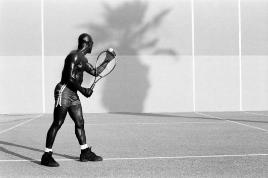 man playing tennis by himself