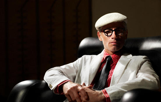 Stylish Man In White Suit Wearing Glasses