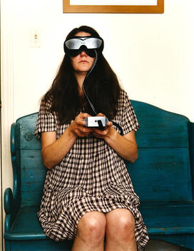 Woman Sitting On A Bench Wearing A Head Mounted Display