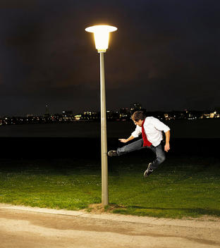Goofy Man Karate Kicking Lamp Post