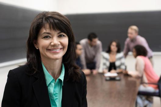Teacher smiling in classroom