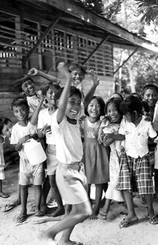Black and white photograph of children dancing