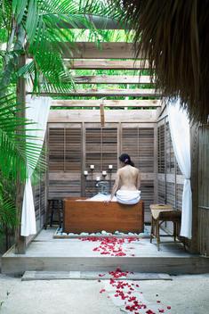 spa, tropical spa, outdoor spa, rose peddles