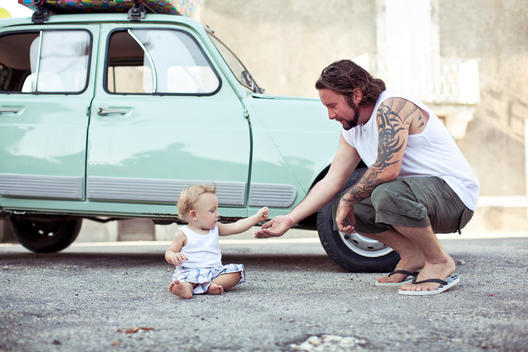 father and son by and antique car